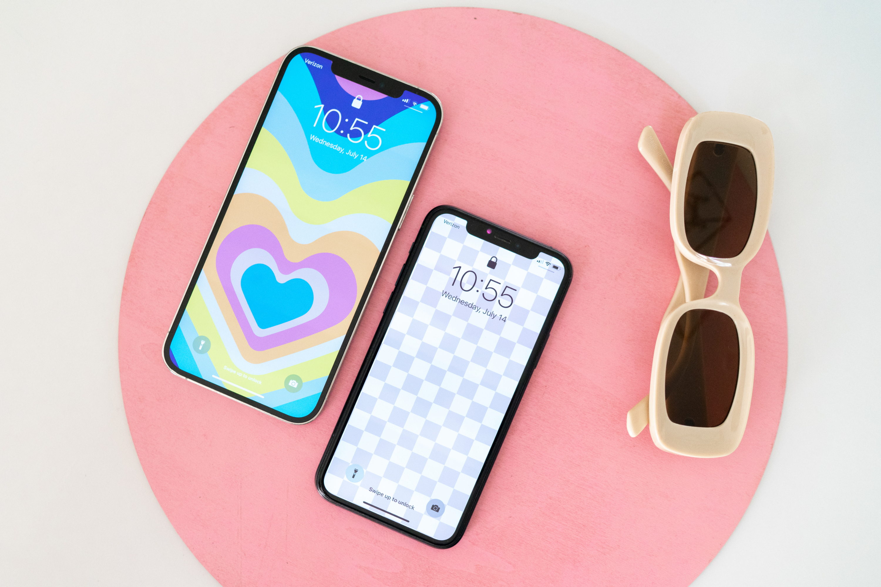 Phones with MOXYO wallpaper and sunglasses background
